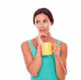 Worried brunette woman with coffee mug Royalty Free Stock Photo