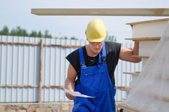 Worried builder on site with a document Royalty Free Stock Images
