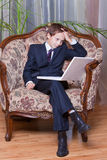 Worried business boy working on computer Stock Images