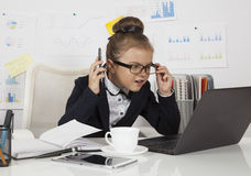 Worried business girl in the office Royalty Free Stock Images