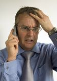 Worried business man. On the phone Royalty Free Stock Image