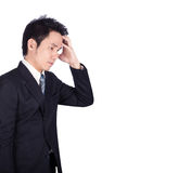Worried business man isolated on white. Background Royalty Free Stock Photos