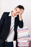 Worried business man with a lot of paper work. Royalty Free Stock Images