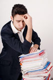 Worried business man with a lot of paper work. Stock Images