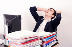 Worried business man with a lot of work. Royalty Free Stock Images