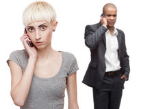 Worried business people calling by mobile telephone Royalty Free Stock Images