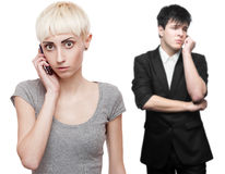 Worried business people calling by mobile telephone Royalty Free Stock Image