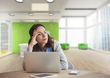 Worried business woman at a desk using a computer Stock Photo