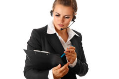 Worried business woman with headset and clipboard Stock Images