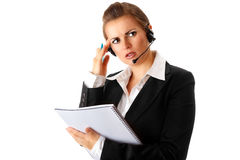 Worried  business woman with headset and notebook Stock Photography