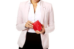 Worried business woman looking into her empty wallet.  Royalty Free Stock Photo