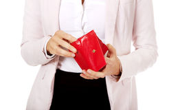 Worried business woman looking into her empty wallet.  Stock Images