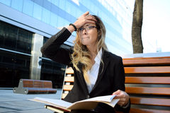 Worried business woman outside her office Stock Photos