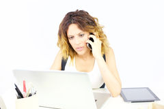 Worried business woman on the phone in office isolated. Gorgeous lady at work in office Royalty Free Stock Image