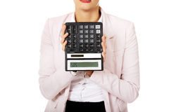 Worried business woman shows sos on calculator Royalty Free Stock Image