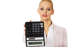 Worried business woman shows sos on calculator stock photos