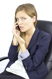 Worried business woman talking on the phone Royalty Free Stock Images