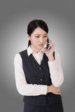 Worried business woman. Unhappy or worried business woman using phone Stock Photos