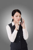 Worried business woman. Unhappy or worried business woman using phone Royalty Free Stock Images
