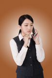 Worried business woman. Unhappy or worried business woman using phone Stock Photo