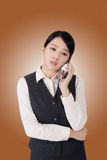 Worried business woman. Unhappy or worried business woman using phone Stock Images