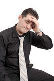 Worried businessman. Worried young businessman isolated on white background royalty free stock image