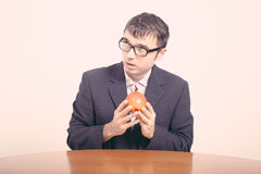Worried businessman with apple Royalty Free Stock Photography