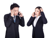 Worried businessman and businesswoman talking on smartphone isol Stock Images
