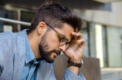 Worried businessman closeup, headache royalty free stock photo
