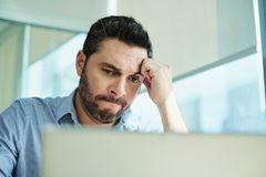 Worried Businessman Got Virus and Data Loss on Laptop Computer stock photography