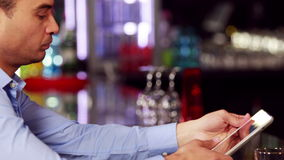 Worried businessman having a drink stock footage