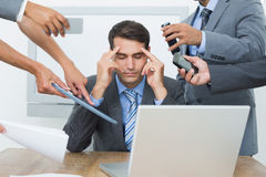 Worried businessman with head in hands Royalty Free Stock Photos