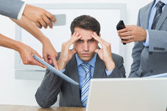 Worried businessman with head in hands Royalty Free Stock Image