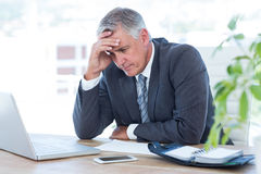 Worried businessman with head in one hand Royalty Free Stock Photo