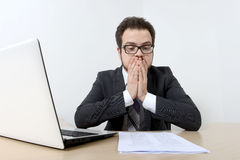 Worried businessman with laptop and document Stock Photography