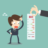 Worried Businessman looking his bills. Finance concept. Royalty Free Stock Photo