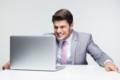 Worried businessman looking at laptop Stock Photo
