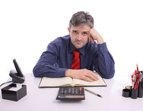 Worried businessman at office. Sitting at desk Royalty Free Stock Images