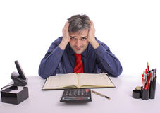 Worried businessman at office. Sitting at desk Royalty Free Stock Photography