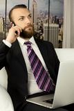 Worried businessman on the phone in office Stock Photos