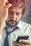 Worried businessman received bad news SMS message Royalty Free Stock Images