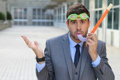 Worried businessman with scuba diving equipment royalty free stock photos