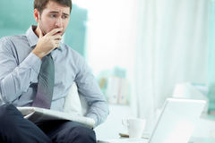 Worried businessman. Businessman sitting at his office and getting bad news Royalty Free Stock Images