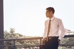 Worried businessman standing at office about work and thinking f royalty free stock photos