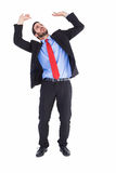 Worried businessman standing and pushing up Stock Image