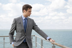 Worried businessman standing by terrace railings Stock Photos