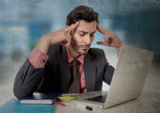 Worried businessman suffering headache working on computer desperate in work stress Royalty Free Stock Photo