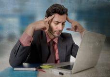 Worried businessman suffering headache working on computer desperate in work stress Royalty Free Stock Photo