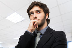 Worried businessman thinking at something Stock Image