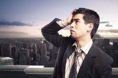Worried businessman on top of a building Stock Image